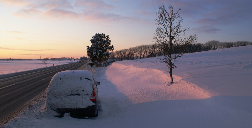 Surive a snowstorm in your car with these helpful tips.